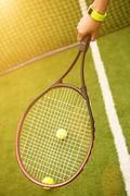 Skillful female athlete carrying tennis racquet Stock Photos