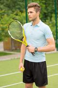 Cheerful tennis player ready to compete Stock Photos