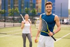 Skillful two athletes playing tennis together Stock Photos