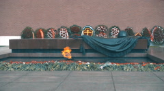 Eternal Flame at the Kremlin wall, and a large number of flowers and wreaths Stock Footage