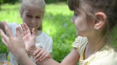 Young Girls Playing clap hands, Friends in the park picnic - stock footage