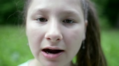 Girl eats potato chips on a picnic in the park Stock Footage