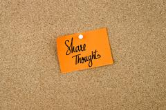 Share Thoughts written on orange paper note Stock Photos