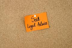 Seek Legal Advice written on orange paper note Stock Photos