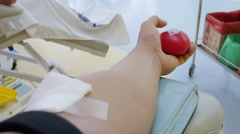male donor giving blood,squeezing the hand,pumping blood - stock footage