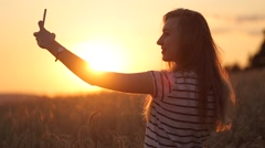Selfie shoot a girl at sunset slow motion video Stock Footage