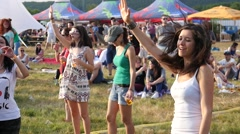 Cute people girls fan spectators enjoying open air music fest dance slow motion Stock Footage