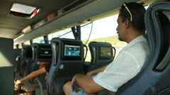 Man watching tv on the bus 2 Stock Footage
