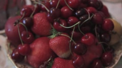 Fruits in a vase. Cherries, strawberries, apples are in the vase. Hitting the Stock Footage