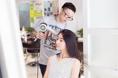 Professional hair stylist Stock Photos
