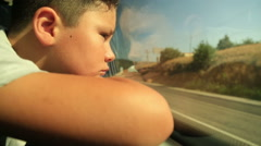 Sad child looking out window 2 Stock Footage