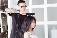 Hairdresser use perm rods Stock Photos
