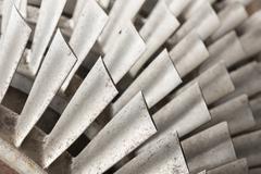 Industrial metal turbine blades. - stock photo