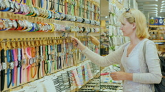 Young woman trying on watches in store for tourists Stock Footage