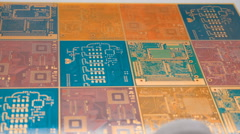 Clean, with no electronic components, printed circuit boards of different colors Stock Footage