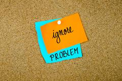 Ignore Problem written on paper notes Stock Photos