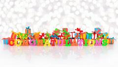 Congratulations colorful text on the background of varicolored gifts Stock Photos