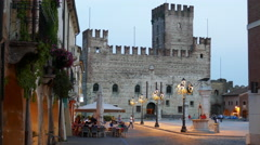 Marostica - Piazza degli Scacchi and the lower castle at dusk Stock Footage