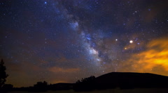 Astro Time Lapse of Milky Way through Clouds over Hill in Arizona  Stock Footage