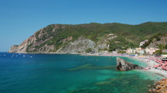 Sandy beach full of tourists in Monterosso al Mare Stock Footage