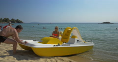 Family sailing on pedal boat in the sea Stock Footage