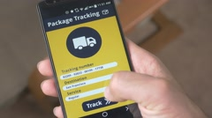 4K Package Tracking App on Smartphone Screen  New Technology - stock footage