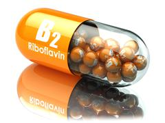 Vitamin B2 capsule. Pill with riboflavin. Dietary supplements. - stock illustration