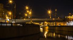 embankment,  reflection in water , motion night scene - stock photo