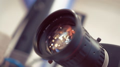 The lens of the surveillance camera shimmers in the light - stock footage