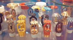 A wide range of fire sprinklers, different colors and sizes, on the glass shelf Stock Footage