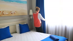 Maid Cleans The Room At The Hotel - stock footage