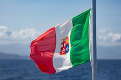 Italian Flag at ferry between Sicily and Aeolian Islands - stock photo