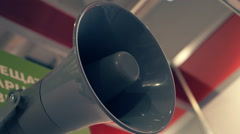 Grey megaphone to broadcast the speech on the wall Stock Footage