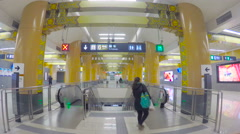 Beijing subway escalator down with traditional Chinese gate decoration. Stock Footage