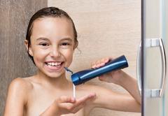 Girl bathing under shower - stock photo