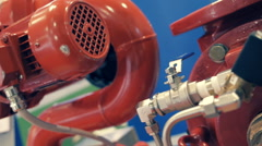 The electric motor fire extinguishing systems is painted red Stock Footage