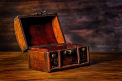beautiful vintage treasure of mystery chest on wooden background with place f - stock photo
