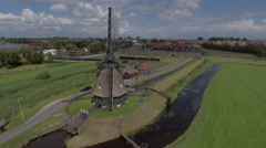 Aerial of windmill in Volendam, Holland - stock footage