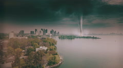 Aerial footage of a large F5 tornado causing destruction in a large modern city. Stock Footage