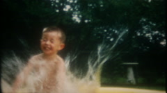 Happy boy runs and jumps into backyard pool at home,3414 vintage film home movie Stock Footage