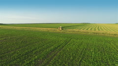 Harvesters Work on Green Field Stock Footage