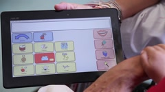 Help children with mental disabilities to make therapy with tablet mental games Stock Footage