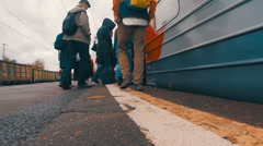 Passengers enter the door of the train Stock Footage