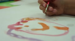 Kid drawing with brush watercolor paint Stock Footage