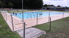 Public pool with people, slider shot Stock Footage