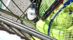 someone taking tennis ball and racket from cart, slider shot - stock footage