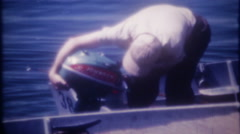 3421 a Johnson Sea Horse outboard motor on fishing boat-vintage film home movie Stock Footage