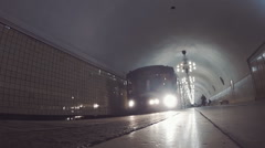 Moscow metro station. Subway train arrives at the station and leaves the station - stock footage
