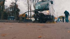Car of cleaning streets goes forward and sweeping the sidewalk Stock Footage
