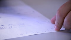 Hands male businessman close-up, making notes in the phone book. Stock Footage